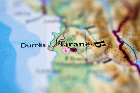 Shallow depth of field focus on geographical map location of Tirane Tirana city Albania Europe continent on atlas 版權商用圖片