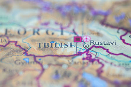 Shallow depth of field focus on geographical map location of Tbilisi city Georgia Europe continent on atlas