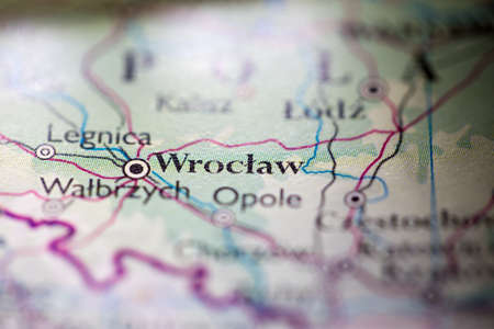 Shallow depth of field focus on geographical map location of Wroclaw city Poland Europe continent on atlas