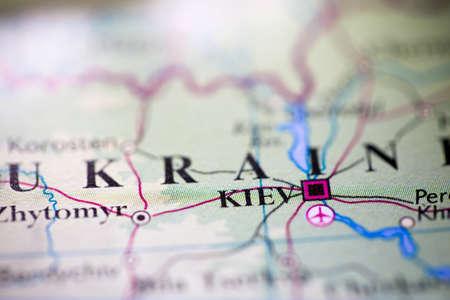 Shallow depth of field focus on geographical map location of Kiev city Ukraine Europe continent on atlas 版權商用圖片