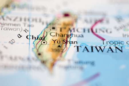 Shallow depth of field focus on geographical map location of Mount Yu Shan in Taiwan Asia continent on atlas Standard-Bild