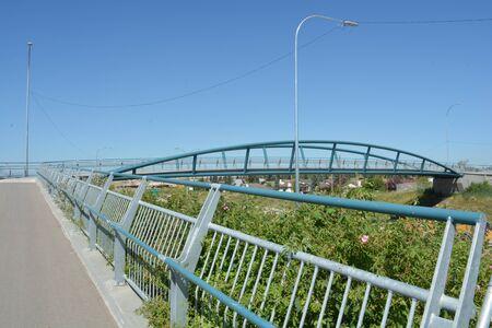 Pedestrian bridge and handrail crossing highway