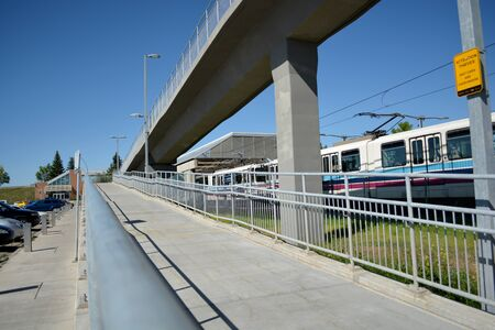 Pedestrian walkway by train track line at city station. Banco de Imagens