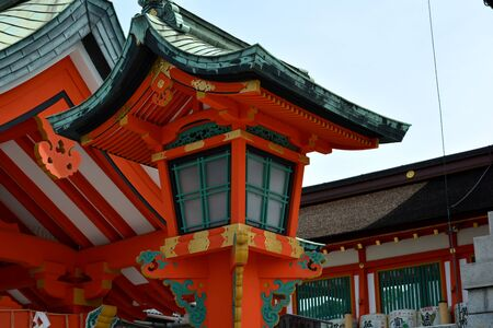 Wooden Japanese Shrine Lantern in Red Coloured Temple Фото со стока