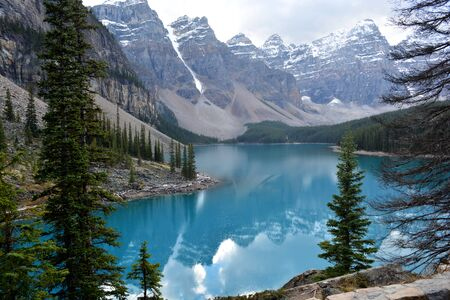 Rocky Mountains Surrounding Beautiful Green - Blue Coloured Lake