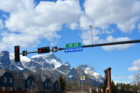 Traffic light on street in mountain town with beautiful mountain range 스톡 콘텐츠