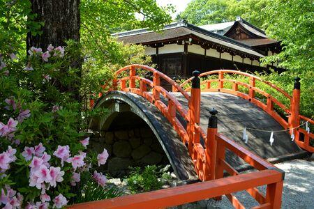 Red Japanese Shrine Bridge in Japanese Garden