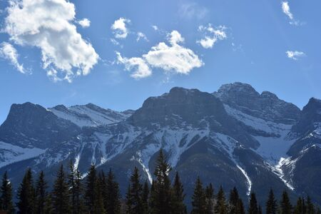 Snow-covered Rocky Mountains on a Summer Day