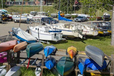 Sail boat yard with small sailing boats and kayaks. Recreational sailing and boating.