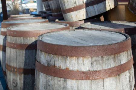 Vintage Wood Barrels Stacked Outside on Heritage Property