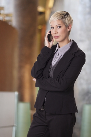 Trendy young woman in business suit talks on phone  Stock Photo - 19620434
