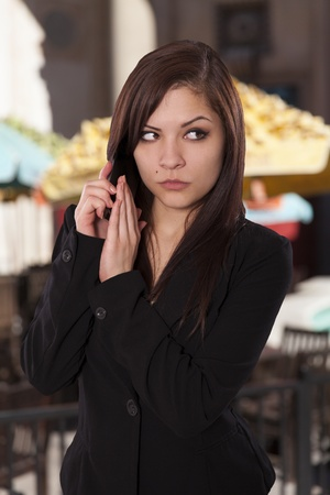 seeks: Business woman seeks privacy by placing her hand over her phone  Stock Photo