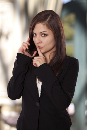 seeks: Beautiful business woman seeks quiet for her phone conversation  Stock Photo