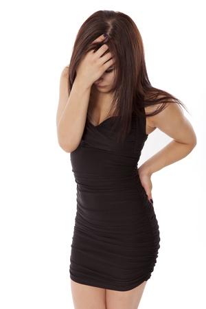 head ache: Sad woman has a major head ache, isolated on a white background