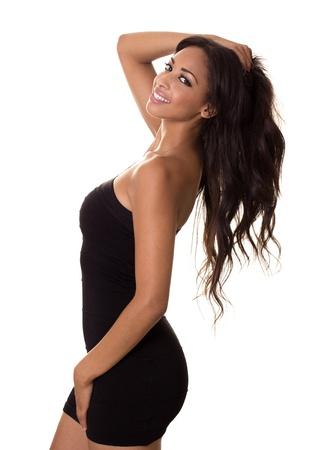 american sexy: Сексуальная женщина начинает мигать красивая улыбка, играя с ее волосами Фото со стока