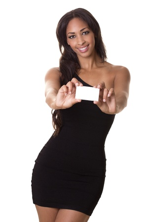 A beautiful woman with a perfect smile holds a business card  Stock fotó