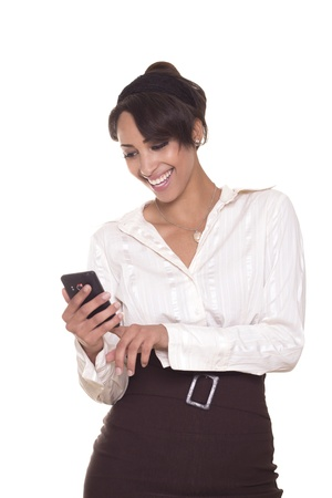 Sexy, young business women laughs while using her cell phone