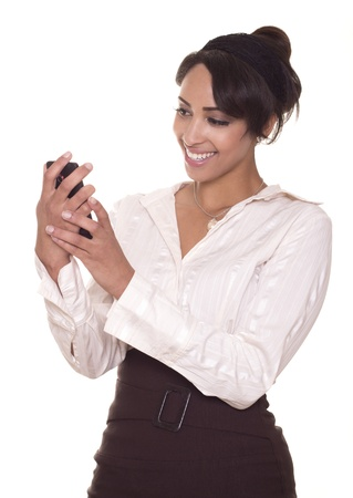 Sexy young business women smiles as she video chats on her phone