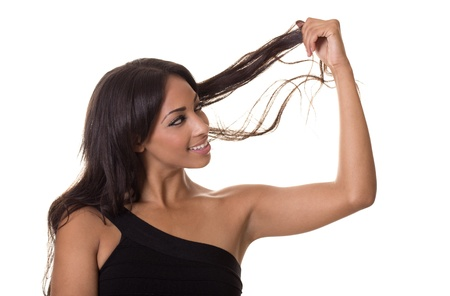 split ends: Sexy woman with healthy hair looks for split ends  Stock Photo