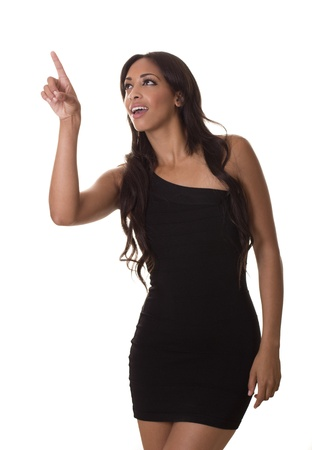 uses a computer: An exotic model in a little black dress uses a virtual computer