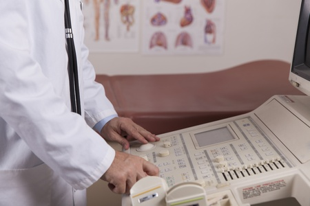 transducer:  A Stenographer sets up an ultrasound machine for the next patient