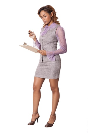 hour glass figure: Pretty woman in a skirt looks at a clipbaord with a serious face isolated on white background