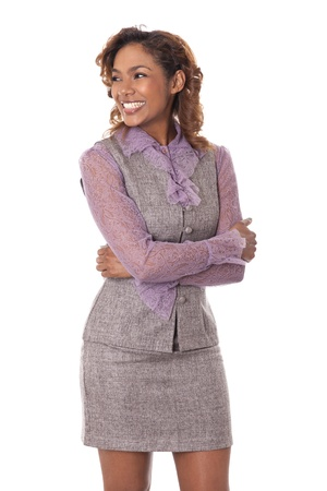 Very happy young business woman flashes a perfect smile while looking to the side