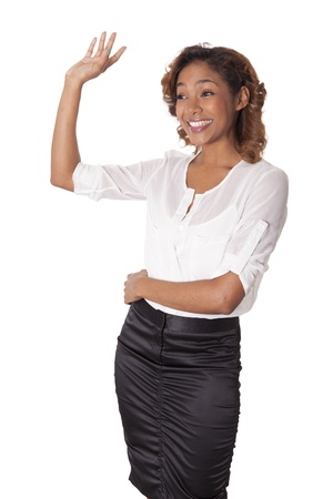 Elegant woman in a black skirt waves to friends with a big smile on white background
