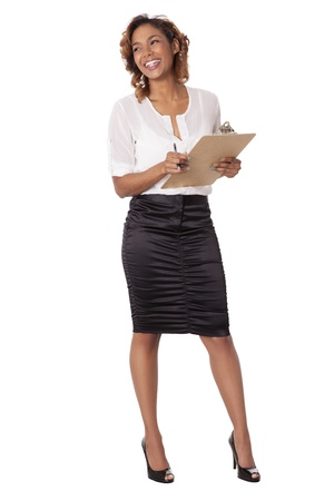 Beautiful woman laughs while holding a clipboard and looks to the side, isolated on white background