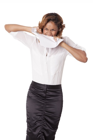 Frustrated business woman rips papers with her teeth, isolated on white background