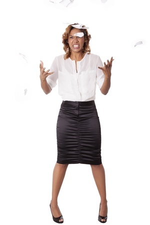 Frustrated office worker throws ripped paper into the air, isolated on white background