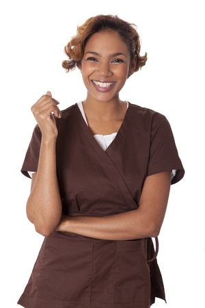 Happy woman stands smiling in scrubs, isolated on white background  Stock fotó