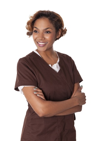 hour glass figure: Smiling woman stands with arms crossed in scrubs, isolated on white background  Stock Photo