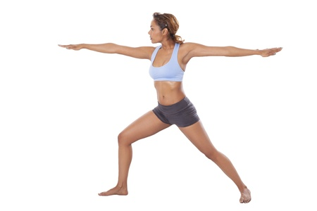 Fit, young woman performs Yoga isolated on white background  Stock fotó
