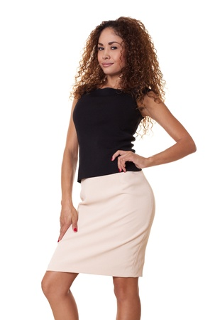 Beautiful, confident  latin businesswoman in a form fitting skirt