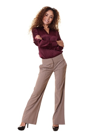 confidently: Latin woman stands confidently with arms crossed
