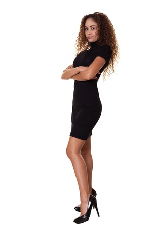 confidently: Beautiful woman smiles confidently in little black dress