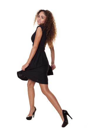 black: Beautiful Latin woman in a little black dress dances