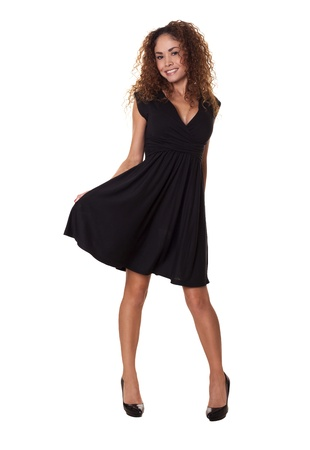 Latin woman in a little black dress dancing and smiling