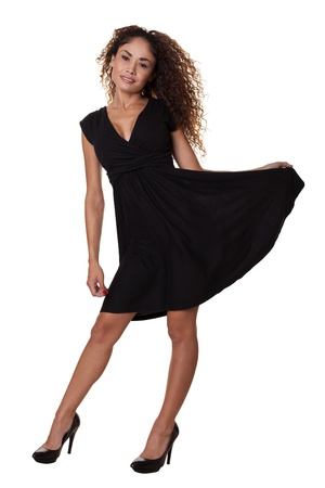 dynamically: Beautiful woman in a little black dress moves dynamically   Stock Photo