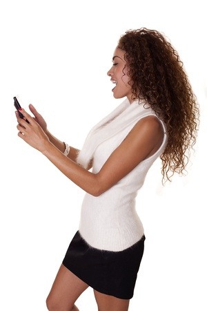Exotic woman enjoys using her phone isolated on a white background   Stock fotó
