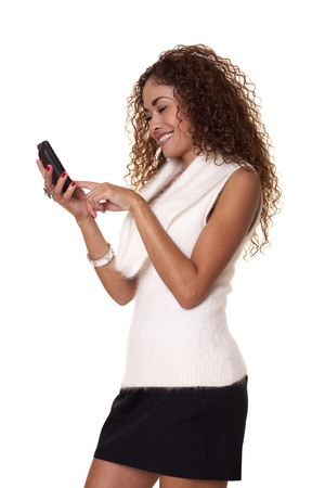 Woman interacts with her cell phone isolated on a white background   Stock fotó