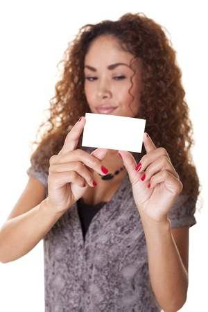 Beautiful woman holds out a blank business card isolated on white background  Stock fotó