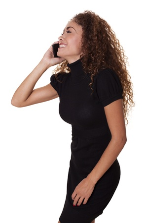 Happy womain in a little black dress laughs while talking on phone, isolated on a white background   Stock fotó