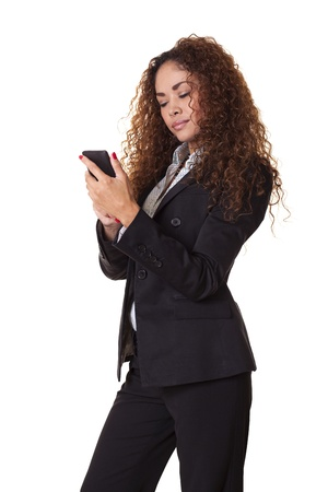 Serious woman in a business suit examines her phone, isolated on a white background