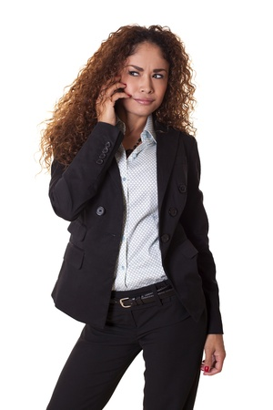 Office worker is annoyed while talking on her phone, isolated on a white background