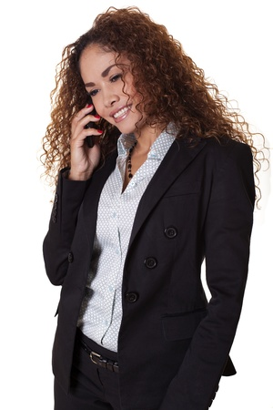 Happy female office worker has a conversation on her phone, isolated on a white background   Stock fotó