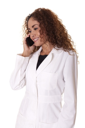 Female Dr  smiles while talking on the phone, isolated on a white background