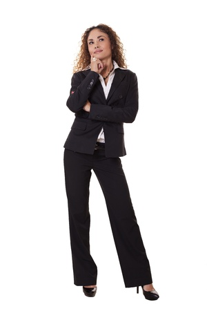 Woman in professional business attire looks to the side, deep in thought, isolated on white background