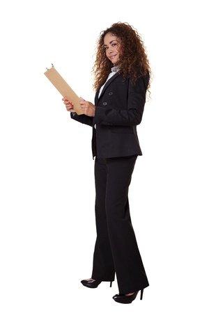 30 s: Business woman stands smiling with a clipboard  Stock Photo